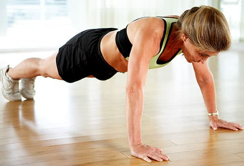 Trainer doing push-up, arms extended