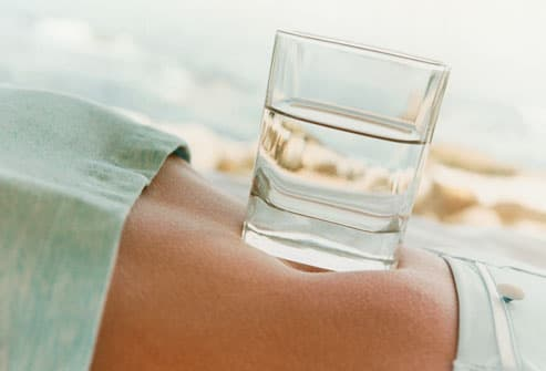 Glass of Water on Woman's Stomach