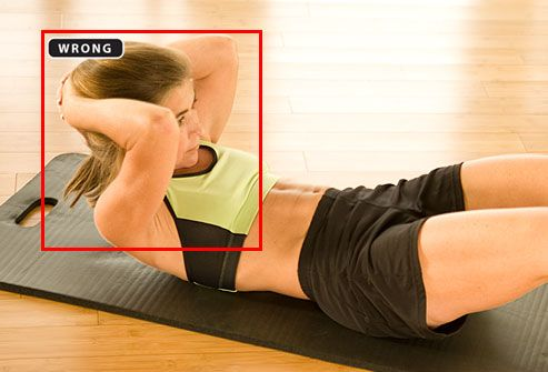 Trainer showing improper form for crunches