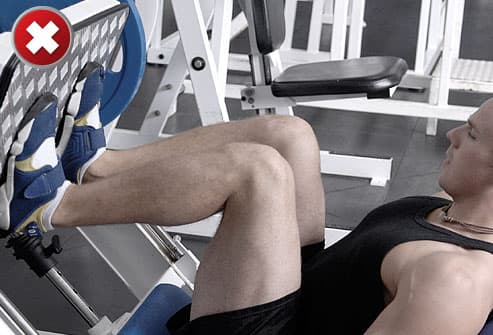 Man doing leg press with knees bent too deeply