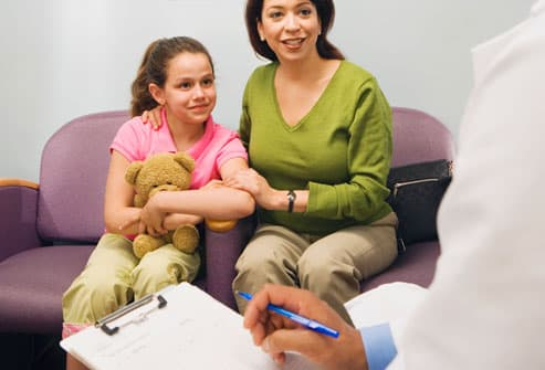 Doctor talking to mom and daughter