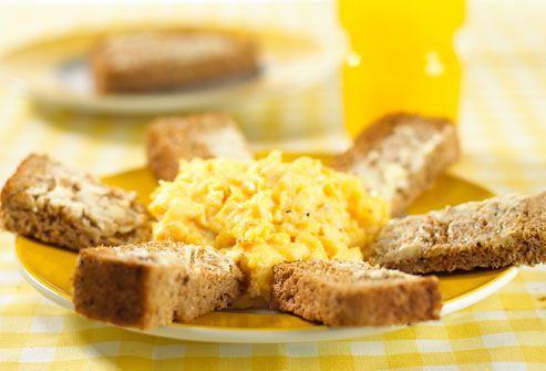 Scrambled egg on a plate with toast