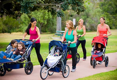 Group of women walking with strollers