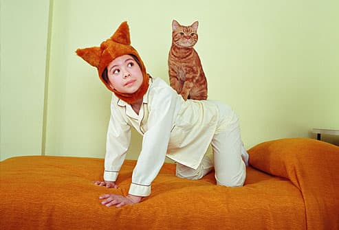 Child pretending to be a cat