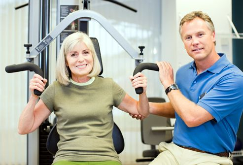 getty_rf_photo_of_woman-_with_personal_trainer_on_weight_machine.jpg