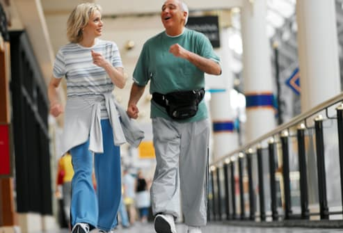 getty_rm_photo_of_couple_powerwalking_in_mall.jpg