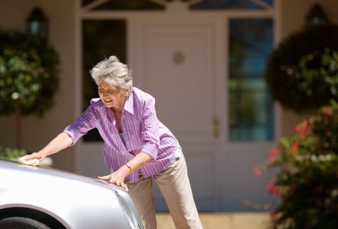 Mature woman washing car