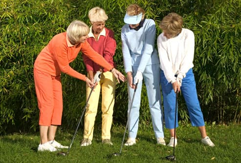 Women taking golf lessons