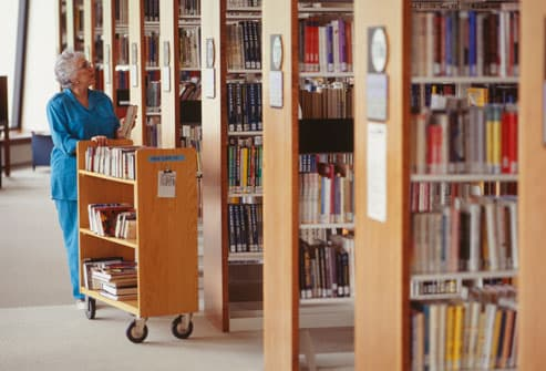 Woman volunteering in library