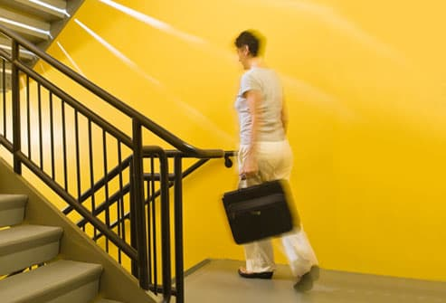 Woman walking down stairwell