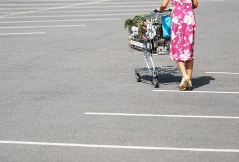 Woman walking across parking lot