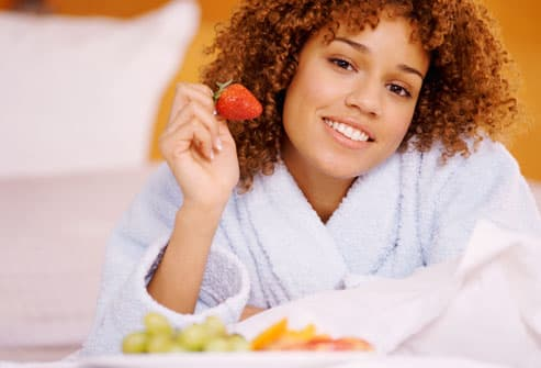 Smiling Woman With Strawberry