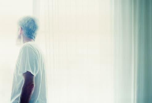 Man Looking Out Blown Out Window
