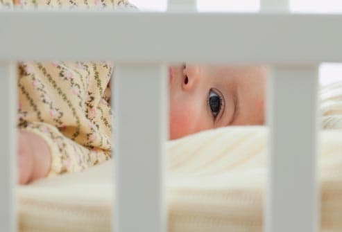 child laying in crib