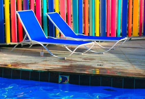 chairs on deck by pool