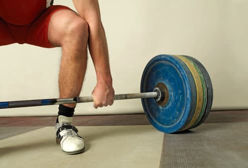 Weightlifter and Heavy Barbell