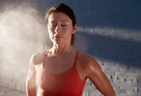 sweating woman with calm expression