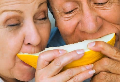 Mature couple sharing fruit