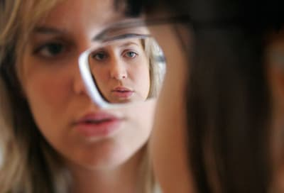 Woman seen through eyeglasses of another