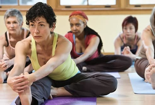 older multi-ethnic women in yoga class