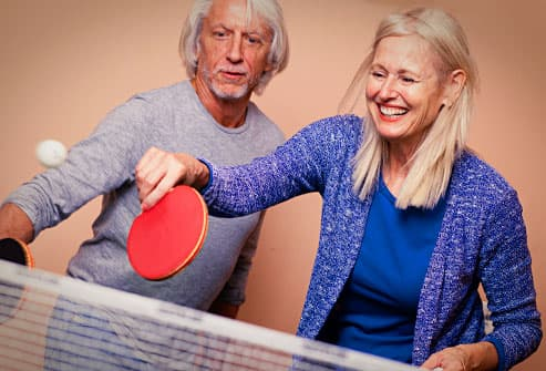 mature couple playing ping pong