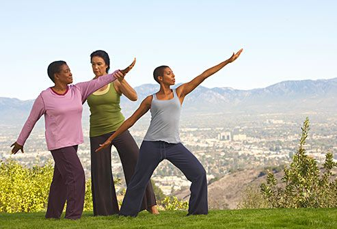 women doing tai chi on hill