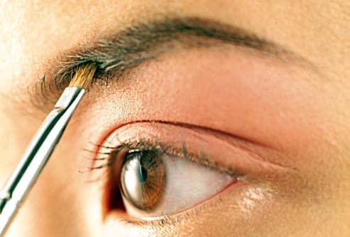woman applying eyebrow makeup