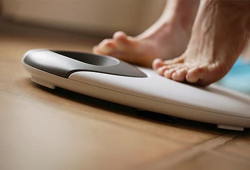 Close up of feet on bathroom scale