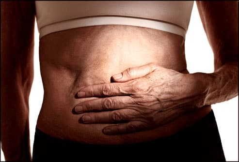 Midsection of person holding stomach