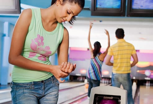 Young woman with bowling sprain