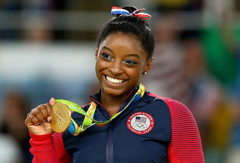simone biles with gold medal