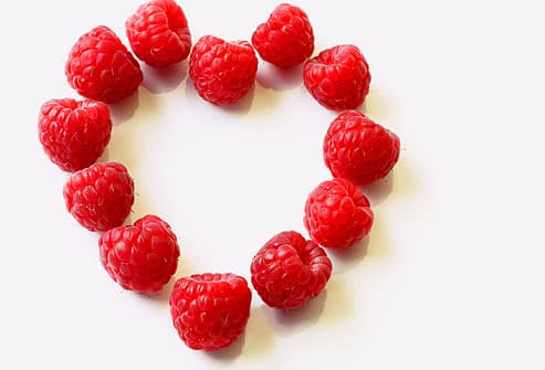 Fresh raspberries in heart-shaped arrangement