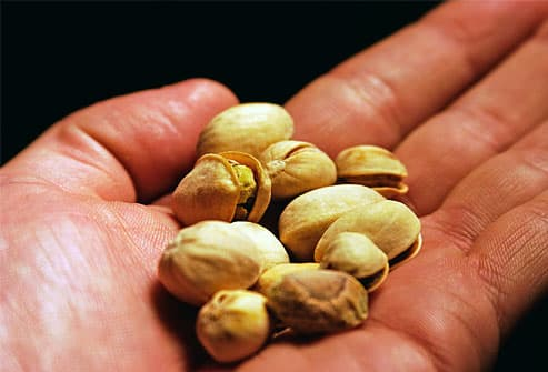 Pistachio nuts in the palm of a hand