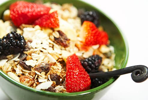 bowl of whole grain cereal with fresh berries