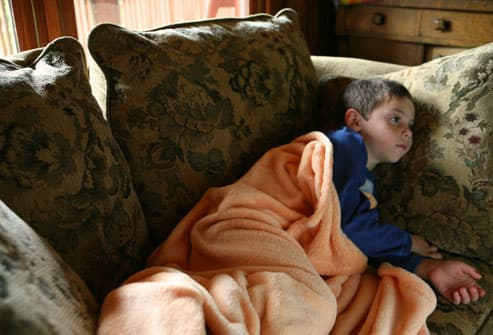 Child with Flu Laying on Couch