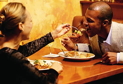 woman feeding man with fork