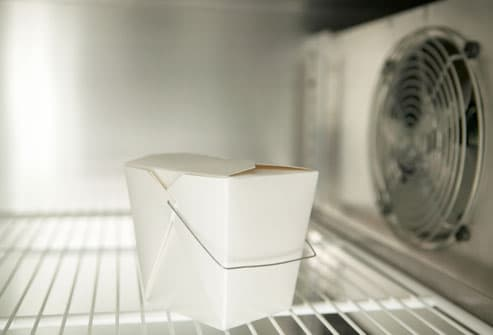 Takeout Carton In Empty Refrigerator