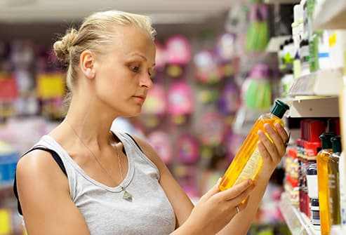 woman shopping for shampoo