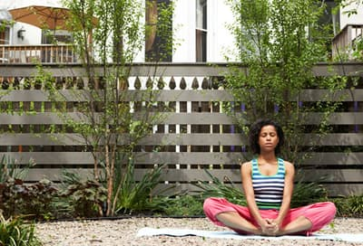 Woman Easing Stress by Meditating