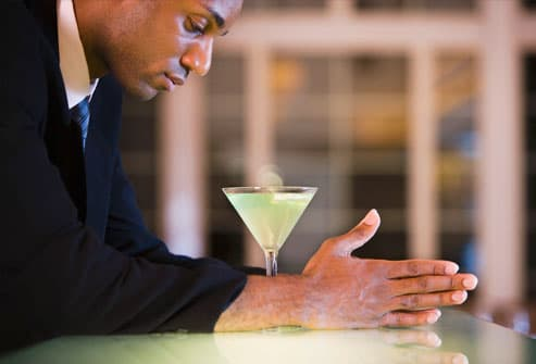 profile of a businessman with a glass of martini