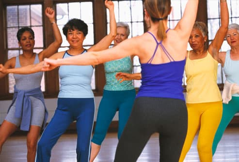 Group of women with instructor in exercise class