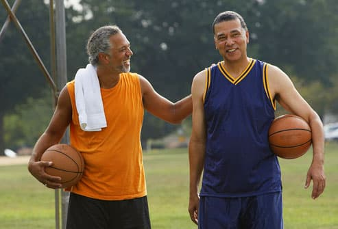 Two men on outdoor basketball court
