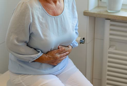 mature woman with stomach pain