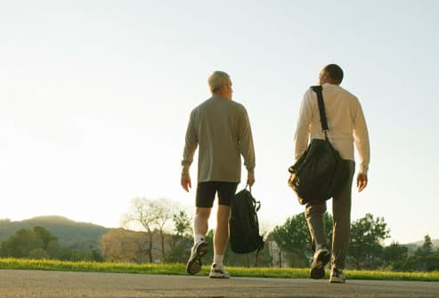 Two Men Walking After Work Out