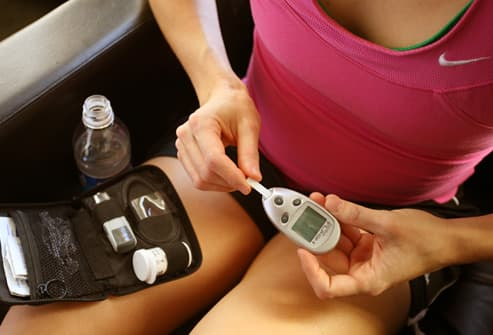 Woman in athletic attire checking glucose