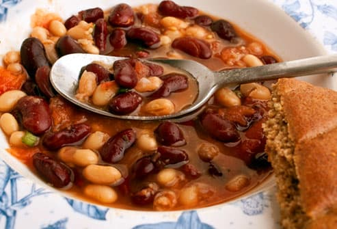 Two bean soup with spoon and bread