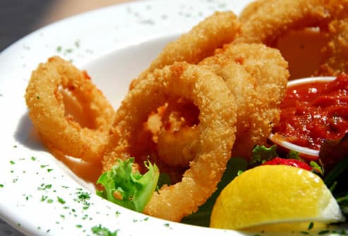 Bowl of fried calamari and sauce