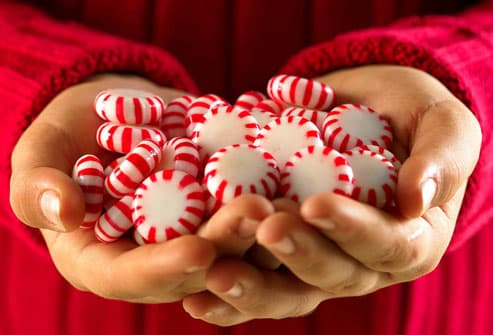 Peppermints in woman's clasped hands