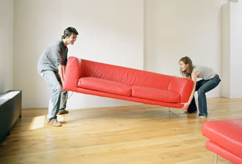Couple Moving Red Couch