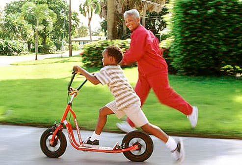 Woman racing grandson on bike